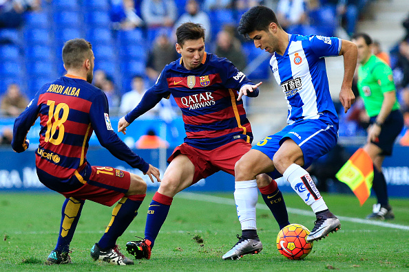 RCD Espanyol's Spanish midfielder Marco Asensio (R) vies with Barcelona's Argentinian forward Lionel Messi (C) during the Spanish league football match RCD Espanyol vs FC Barcelona atthe Power8 stadium in Cornella de Llobregat on January 2, 2016.   AFP PHOTO/ PAU BARRENA / AFP / PAU BARRENA        (Photo credit should read PAU BARRENA/AFP/Getty Images)