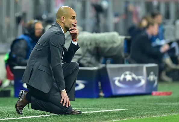 Bayern Munich's Spanish head coach Pep Guardiola follows the action during the UEFA Champions League semi-final, second-leg football match between FC Bayern Munich and Atletico Madrid in Munich, southern Germany, on May 3, 2016. / AFP / John MACDOUGALL (Photo credit should read JOHN MACDOUGALL/AFP/Getty Images)