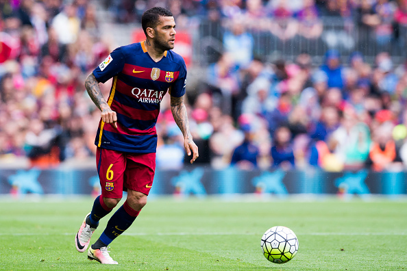 530286206-dani-alves-of-fc-barcelona-runs-with-the-gettyimages