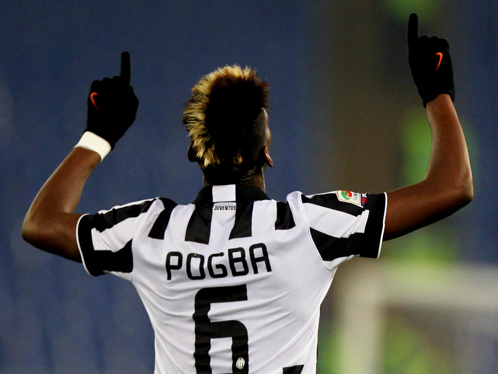 ROME, ITALY - NOVEMBER 22: Paul Pogba of Juventus FC celebrates after scoring the opening goal during the Serie A match between SS Lazio and Juventus FC at Stadio Olimpico on November 22, 2014 in Rome, Italy. (Photo by Paolo Bruno/Getty Images)