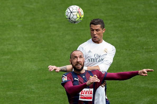 MADRID, SPAIN - APRIL 09: Cristiano Ronaldo of Real Madrid CF wins the header before Ivan Ramis of SD Eibar during the La Liga match between Real Madrid CF and SD Eibar at Estadio Santiago Bernabeu on April 9, 2016 in Madrid, Spain.  (Photo by Gonzalo Arroyo Moreno/Getty Images)