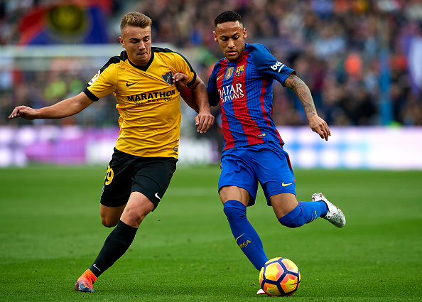 BARCELONA, SPAIN - NOVEMBER 19: Neymar JR of Barcelona competes for the ball with Ontiveros (L) of Malaga during the La Liga match between FC Barcelona and Malaga CF at Camp Nou stadium on November 19, 2016 in Barcelona, Spain. (Photo by Manuel Queimadelos Alonso/Getty Images)
