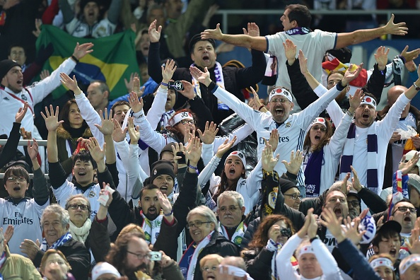 Real Madrid supporters cheer before the Club World Cup football final match between Kashima Antlers of Japan and Real Madrid of Spain at Yokohama International stadium in Yokohama on December 18, 2016. / AFP / Kazuhiro NOGI (Photo credit should read KAZUHIRO NOGI/AFP/Getty Images)