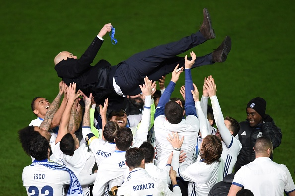 Real Madrid head coach Zinedine Zidane is thrown into the air by Real Madrid players after winning the Club World Cup football final match against Kashima Antlers of Japan at Yokohama International stadium in Yokohama on December 18, 2016. / AFP / Toru YAMANAKA (Photo credit should read TORU YAMANAKA/AFP/Getty Images)