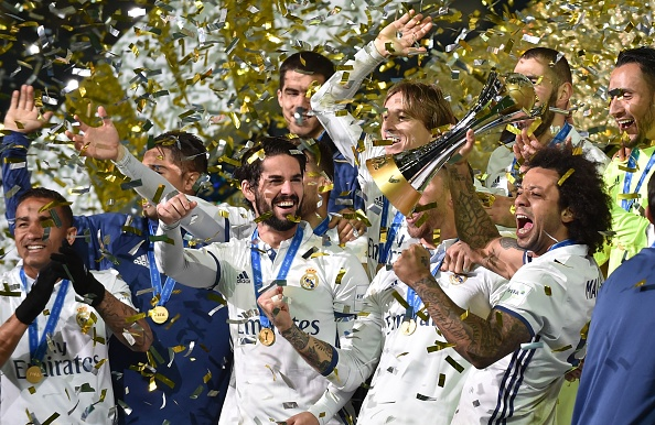 Real Madrid defender Marcelo (front R) and his teammates celebrate with their trophy after winning the Club World Cup football final match between Kashima Antlers of Japan and Real Madrid of Spain at Yokohama International stadium in Yokohama on December 18, 2016. / AFP / KAZUHIRO NOGI (Photo credit should read KAZUHIRO NOGI/AFP/Getty Images)