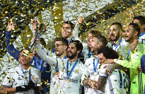 Real Madrid players celebrate with their trophy after winning the Club World Cup football final match between Kashima Antlers of Japan and Real Madrid of Spain at Yokohama International stadium in Yokohama on December 18, 2016. / AFP / KAZUHIRO NOGI (Photo credit should read KAZUHIRO NOGI/AFP/Getty Images)