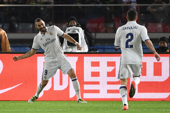 Real Madrid forward Karim Benzema (L) celebrates scoring during the Club World Cup football final match between Kashima Antlers of Japan and Real Madrid of Spain at Yokohama International stadium in Yokohama on December 18, 2016. / AFP / Toshifumi KITAMURA (Photo credit should read TOSHIFUMI KITAMURA/AFP/Getty Images)