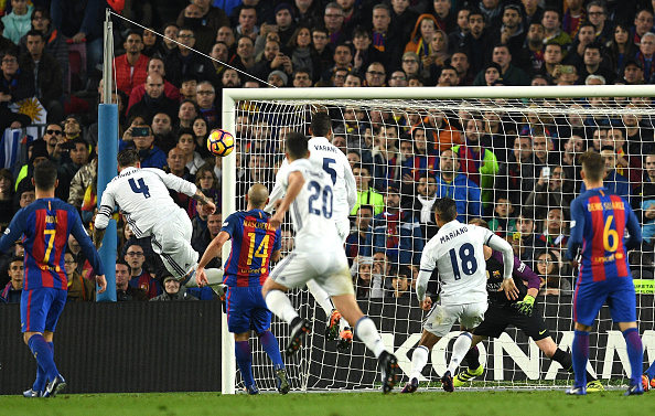 BARCELONA, SPAIN - DECEMBER 03: Sergio Ramos of Real Madrid heads to score his team's first goal during the La Liga match between FC Barcelona and Real Madrid CF at Camp Nou on December 3, 2016 in Barcelona, Spain. (Photo by David Ramos/Getty Images)