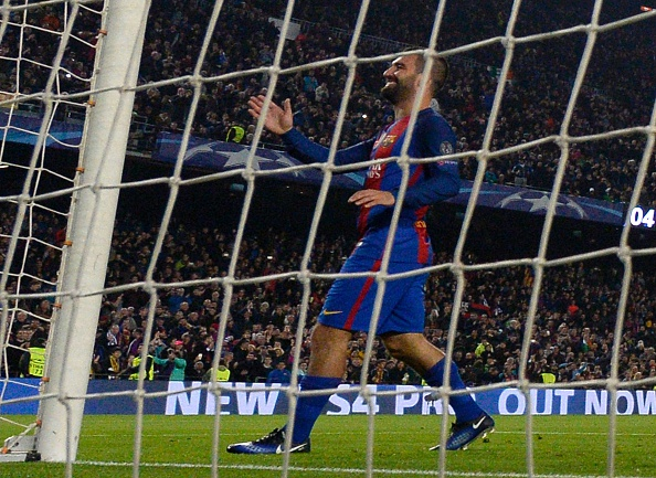 Barcelona's Turkish forward Arda Turan celebrates after scoring during the UEFA Champions League Group C football match FC Barcelona vs Borussia Moenchengladbach at the Camp Nou stadium in Barcelona, on December 6, 2016. / AFP / LLUIS GENE (Photo credit should read LLUIS GENE/AFP/Getty Images)